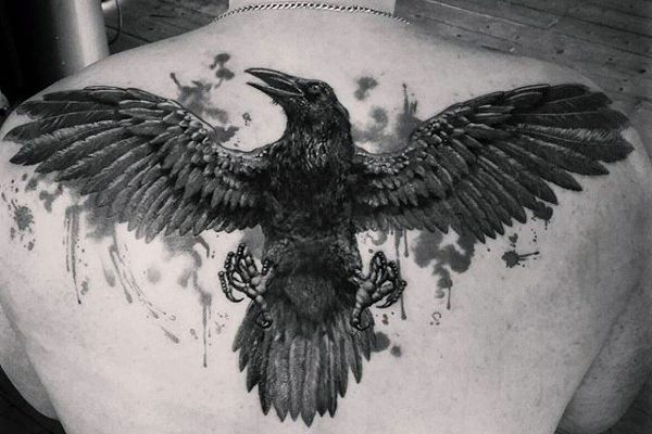 back-tattoos-for-men-black-raven-in-flight